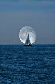 sailboat with moon on the horizon